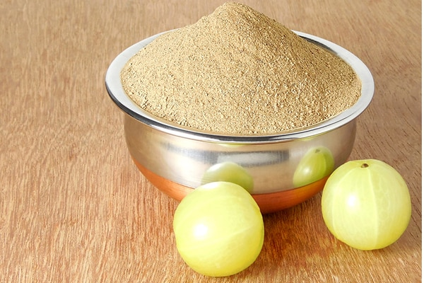 Olive oil and amla powder to promote hair growth