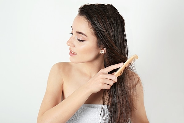 Comb hair when damp