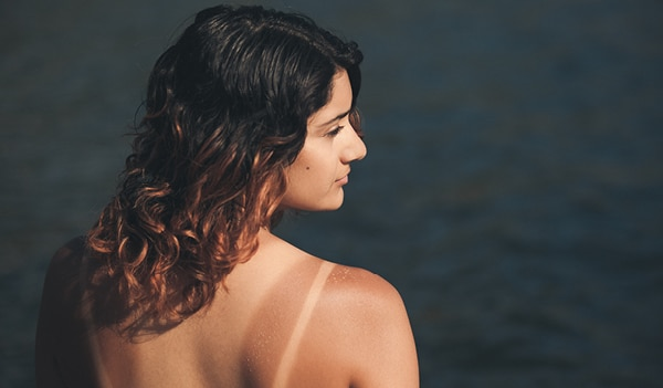 Your go-to guide for dealing with stubborn tan lines this summer
