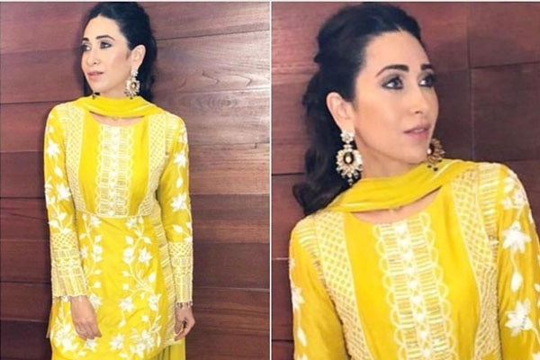Karisma Kapoor – textured, large curls in half-up half-down style