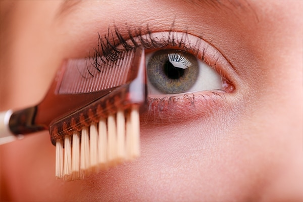 Use a lash comb