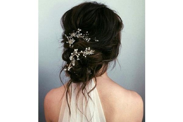 Accessorized messy bun wedding hairstyles