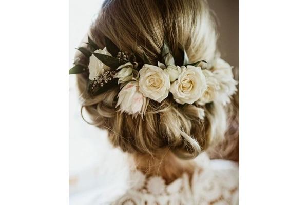 Elegant updo with rose crown wedding hairstyles