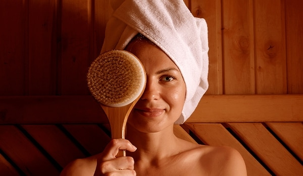 Here are all the benefits of dry brushing (yes, it's a thing) your face