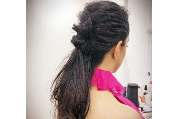 Tousled knotted ponytail