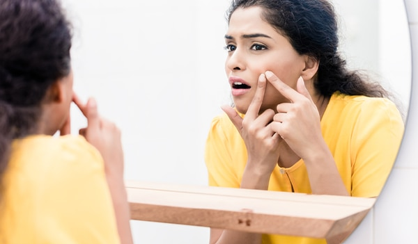 How to prevent a pimple from becoming a full-blown breakout