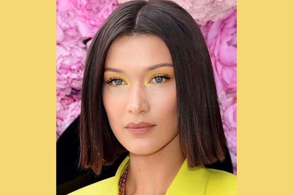 Bella Hadid's subtle neon yellow eyes