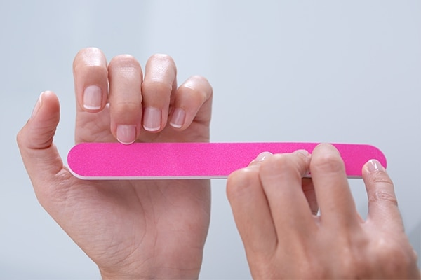 Get your hands on a soft nail file