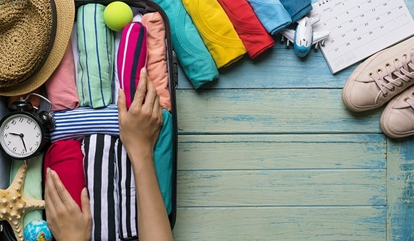 Planning a vacay? Travel light with these makeup packing tips...