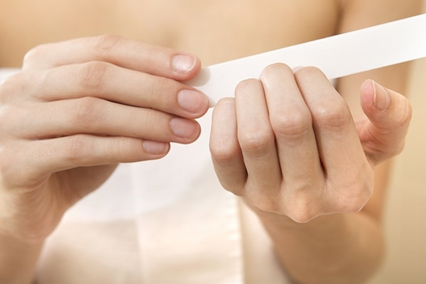 Using back-and-forth motion to file your nails