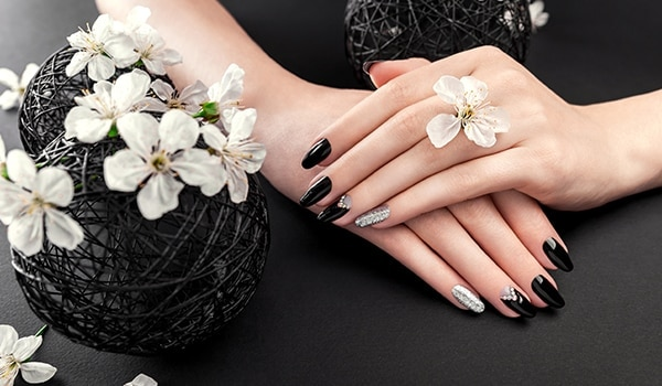 These black nail art designs are dark and full of terrors...
