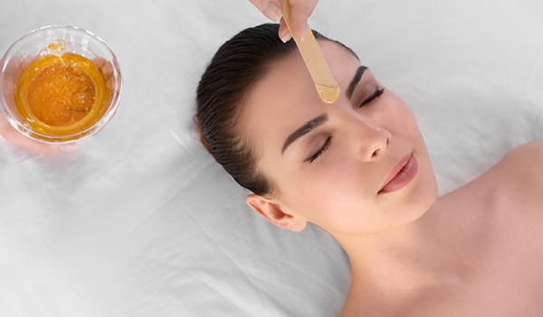 Tips to soothe irritated facial skin after waxing or threading