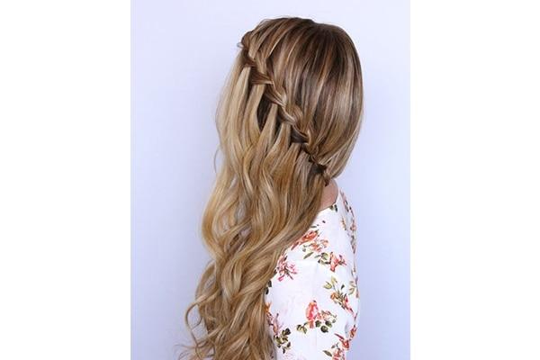 Side swept waterfall braid