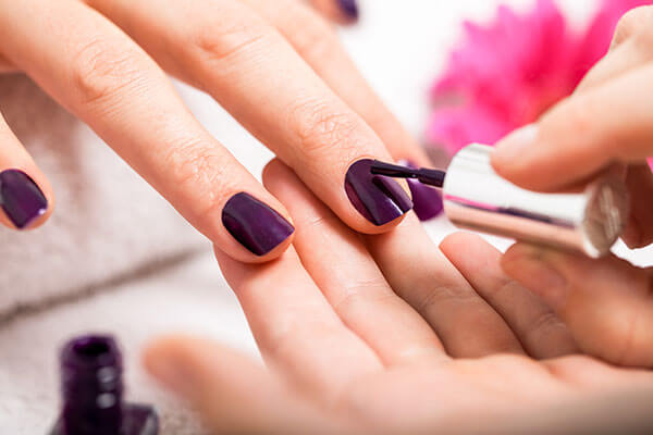 You apply thick coats of nail colour