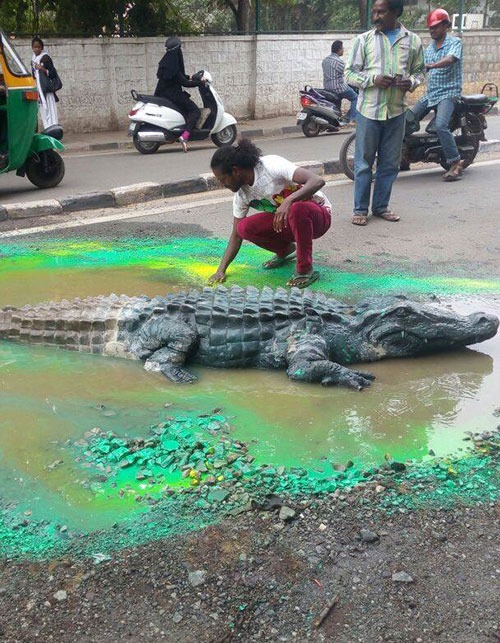 ATTACKING CIVIC AUTHORITIES WITH ART ONE POTHOLE AT A TIME