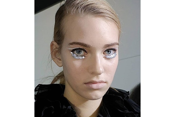 Metallic lashes and white liner—Giambattista Valli