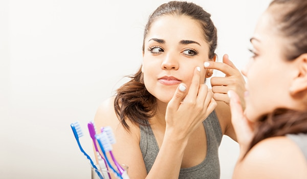 Everything you need to know about a 'blind' pimple and how to treat it