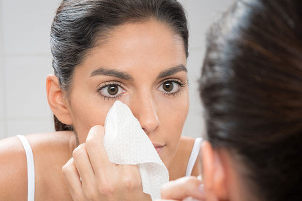 blotting paper trick to keep your under eye concealer from creasing