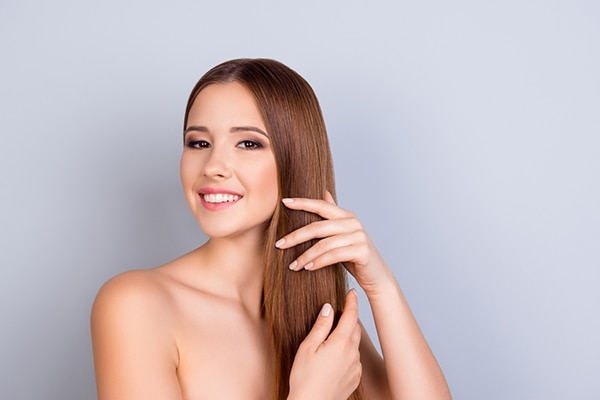 Tip #2: Say goodbye to flyaways by applying the product with your hands