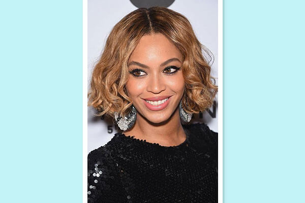 curly bob hairstyle on red carpet