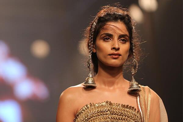 Dramatic earrings at Amit Aggarwal