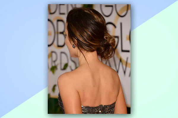 Side chignon with a tube dress/gown