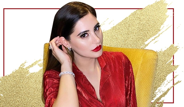 Get the look: Nargis Fakhri's classic bold lip and high-on-highlighter look is statement-worthy