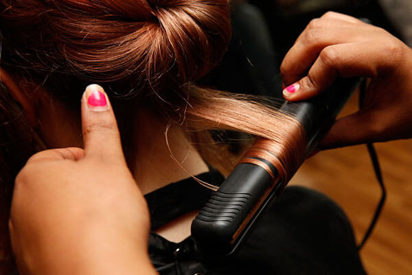 place the straightener towards the hair length