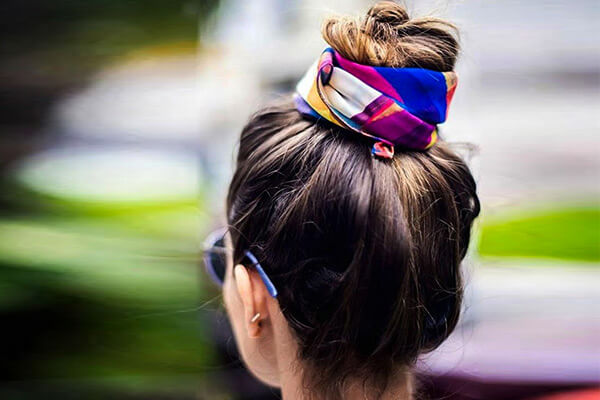 printed scarf on top knot hairstyle