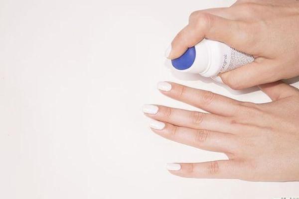 Wipe off polish with hairspray
