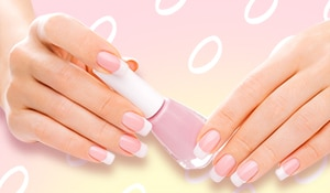 Score a salon-like French manicure at home using a rubber band!