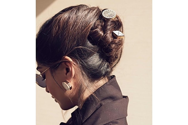Twisted bun with chunky accessories